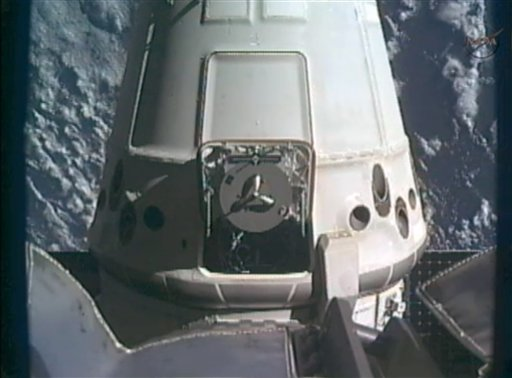 This framegrab image from NASA-TV shows the SpaceX Dragon capsule just after the capsule is released from the Canadarm2 at 5:49 a.m. today.