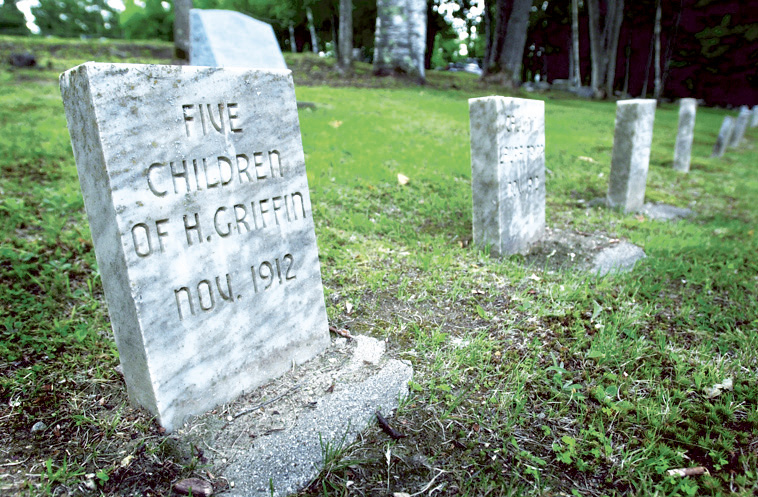 Stones mark the graves of island residents whose bodies were dug up and reburied at what became Pineland Farms in New Gloucester. Jack Milton
