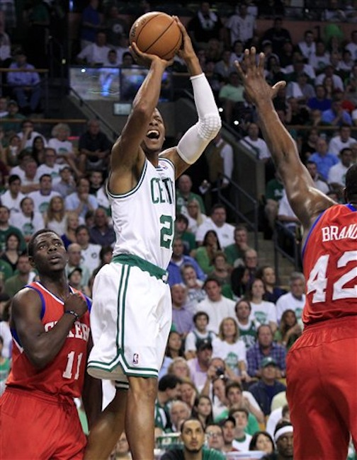 In this Saturday, May 26, 2012 photo, Boston Celtics guard Ray Allen (20) gets a jumper off against the defense of Philadelphia 76ers guard Jrue Holiday (11) and forward Elton Brand (42) during the first quarter of Game 7 in the NBA basketball Eastern Conference semifinal playoff series, in Boston. (AP Photo/Elise Amendola) Ray Allen, Elton Brand, Jrue Holiday
