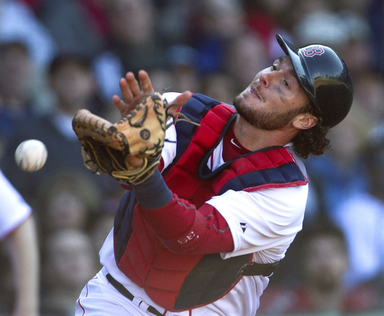 Red Sox catcher Jarrod Saltalamacchia is unable to get his glove on a foul ball hit by the Orioles' Adam Jones at Fenway Park on Sunday. The Red Sox gave up three runs in the 17th inning and lost 9-6.