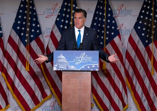 "In this May 23, 2012, photo, Republican presidential candidate Mitt Romney gestures during a speech at the Latino Coalition annual economic summit at the U.S. Chamber of Commerce in Washington. Government spending and debt are emerging as a campaign tug-of-war. Romney blames President Barack Obama for a ""prairie fire of debt."" Obama calls the charge a ""cowpie of distortion."" Both candidates are reaching for unaligned, independent voters anxious about who's going to get stuck with the bill. (AP Photo/Evan Vucci)"