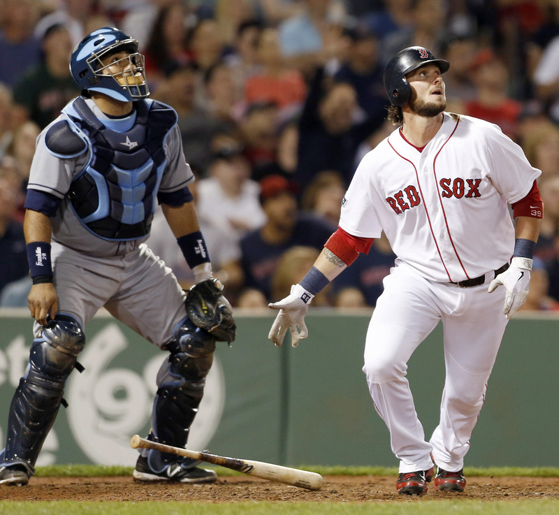 Red Sox catcher Jarrod Saltalamacchia and Rays catcher Jose Molina watch Saltalamacchia's two-run homer at Fenway Park on Saturday. The ninth-inning home run gave the Red Sox the win, 3-2.