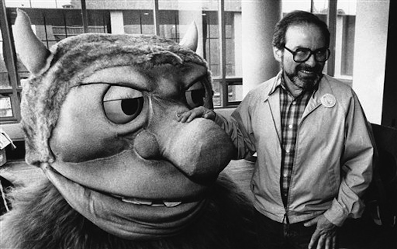 """In this Sept. 25, 1985 file photo, author Maurice Sendak poses with one of the characters from his book """"Where the Wild Things Are,"""" designed for the operatic adaptation of his book in St. Paul, Minn. Sendak died, Tuesday, May 8, 2012 at Danbury Hospital in Danbury, Conn. He was 83. (AP Photo, file) Standing Smiling Spectacles Looking Away Creativity"""