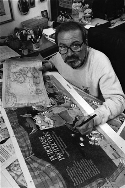 """In this October 1988 file photo, author Maurice Sendak, creator of the best-selling children's book """"Where the Wild Things Are,"""" checks proofs of art for a major advertising campaign in his Ridgefield, Conn., home. Sendak died, Tuesday, May 8, 2012 at Danbury Hospital in Danbury, Conn. He was 83. (AP Photo, file)"""