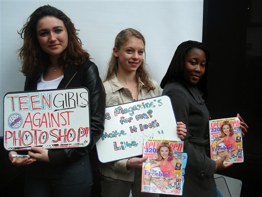 Emma Stydahar, 17, of Croton-on-Hudson, N.Y., left, Julia Bluhm, 14, of Waterville, Maine, and Natasha Williams, 17, of East Flatbush, N.Y., protest outside Seventeen magazine's offices in New York on Wednesday. Bluhm delivered a petition and met with officials from the magazine urging them to publish one spread a month of model photos that have not been altered. She says images of young girls in the magazine present an impossible ideal for today's teens.