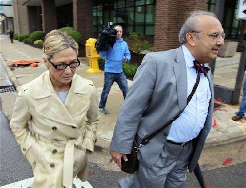Rita Crundwell, former comptroller for Dixon, Ill., leaves federal court in Rockford, Ill., Monday, May 7, 2012, with her attorney Paul Gaziano, after pleading not guilty at her arraignment to charges that accuse her of stealing tens of millions of dollars from the community. Prosecutors contend that Crundwell had been transferring Dixon's money to a secret account since at 1990 and using the money to create one of the nation's leading horse-breeding operations and buy luxury homes, cars and jewelry. (AP Photo/Robert Ray)