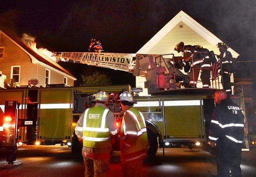 Firefighters from several departments battle a fire on Spring Street in Lewiston late Tuesday night.