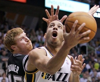 Utah Jazz guard Devin Harris (5) attempts to score past San Antonio Spurs forward Matt Bonner (15) during a May 7 game in Salt Lake City.