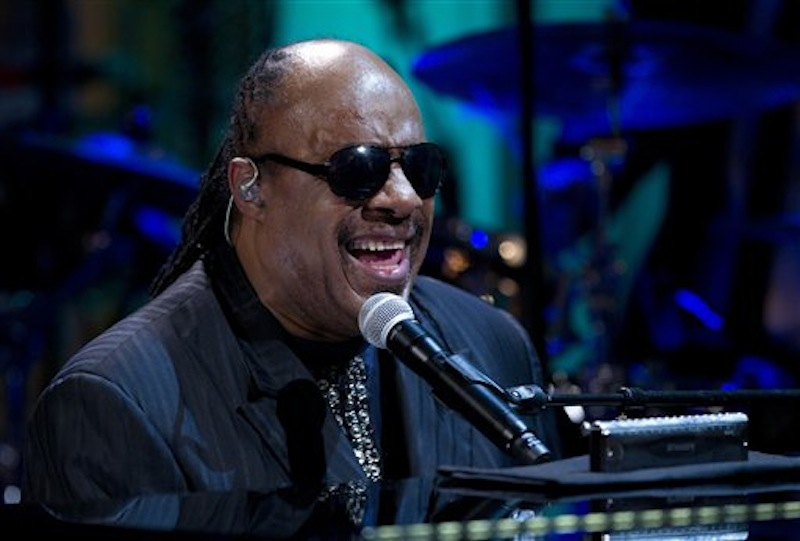 "In this May 9, 2012 file photo, Stevie Wonder performs during the ""In Performance at the White House"" in the East Room of the White House in Washington, honoring songwriters Burt Bacharach and Hal David. Authorities have charged two people, including a man who identifies as Wonder's nephew, with extortion for a plot in which they tried to trade what they said was embarrassing information in exchange for money. (AP Photo/Carolyn Kaster, File)"
