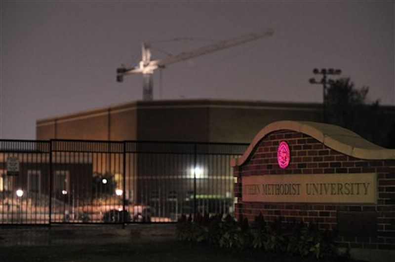 A robbery suspect believed to be armed is in a standoff with police in a crane high above the SMU campus. Early Tuesday, the man fell to his death. (Michael Prengler/Special Contributor)