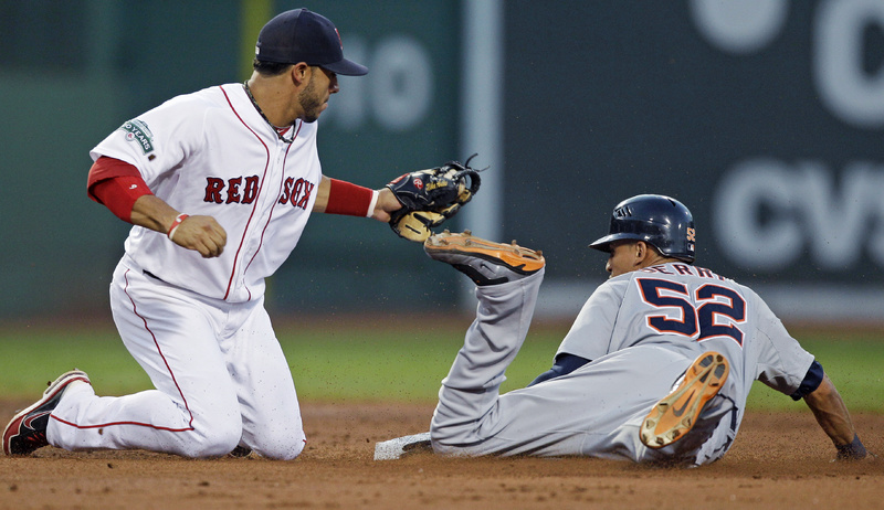 Detroit Tigers' Quintin Berry steals second base as Boston Red Sox shortstop Mike Aviles covers in the third inning at Fenway Park on Thursday. The Red Sox lost, 7-3.