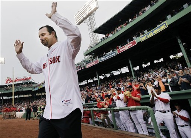 Newly retired Boston Red Sox pitcher Tim Wakefield reacts as he is introduced during a ceremony to honor his career prior to a baseball game against the Seattle Mariners at Fenway Park in Boston, Tuesday, May 15, 2012. (AP Photo/Elise Amendola)
