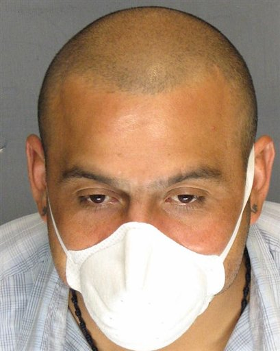 In this undated photo supplied by the San Joaquin County District Attorney's office, Armando Rodriguez is seen wearing a protective mask. Prosecutors say 34-year-old Armando Rodriguez, a tuberculosis patient, has been arrested for refusing to take his medication and missing doctor appointments, and is endangering public health by not treating the airborne disease.