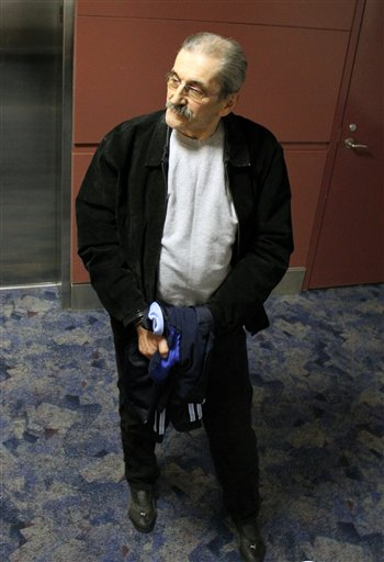Dejan Radojkovic, 61, arrives at McCarran Airport in Las Vegas, for the initial leg of his removal flight back to Sarajevo. The Associated Press photo