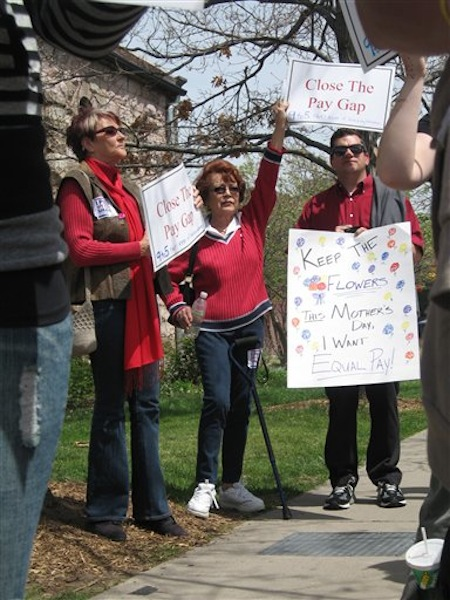 In this April 17, 2012 photo, Wanda Ramey, 65, of Aurora, Colo., attends an Equal Pay Day rally on the University of Colorado campus in Denver. A registered independent, Ramey's top priorities this election year aren't necessarily directly related to the