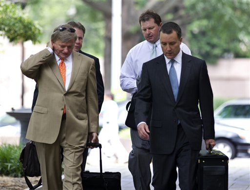 Former Major League Baseball pitcher Roger Clemens, back right, walks with his attorneys Rusty Hardin, front left, and Michael Attanasio, right, to the federal court in Washington, Wednesday, May 23, 2012. (AP Photo/Manuel Balce Ceneta)