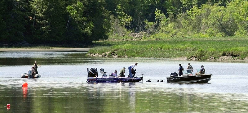 Divers in the water talk to other searchers on boats this morning on the Cathance River in Bowdoinham as they try to find for Santana Dubon, 32, of Portland. He was in a canoe with two family members when the canoe capsized around 7:30 p.m. Saturday evening, according to Sgt. Daniel White of the marine patrol. The two others made it to shore safely, but Dubon has not been found.