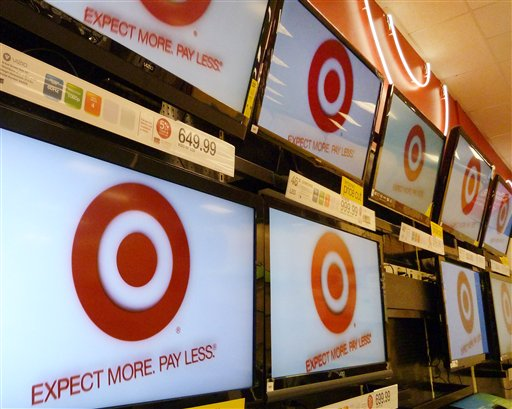 FILE- A Feb. 20, 2012, file photo, shows flat screen televisions at a Target store in Methuen, Mass. Target Corp. is reporting a 1.2 percent increase in first-quarter profit as the discounter pulled in more shoppers for food and trendy fashions. Target�s results come as economists are carefully dissecting consumer spending trends amid growing economic uncertainty. Like many retailers, Target saw that business in April 2012 was disappointing as warmer-than-usual weather earlier in February and March and an early Easter pulled sales forward. (AP Photo/Elise Amendola, File)