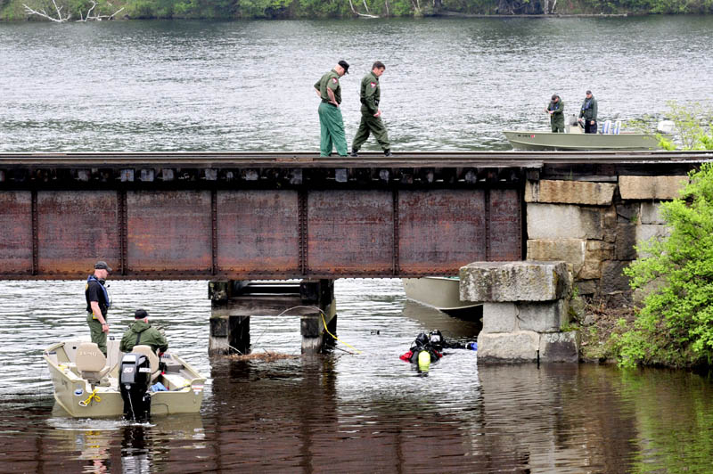 INCH BY INCH: On Tuesday game wardens and divers search the site where Martin Stream enters the Kennebec River in Hinckley a short distance from where missing driver Cora Marley left the roadway and crashed her car on a nearby bridge last Saturday.