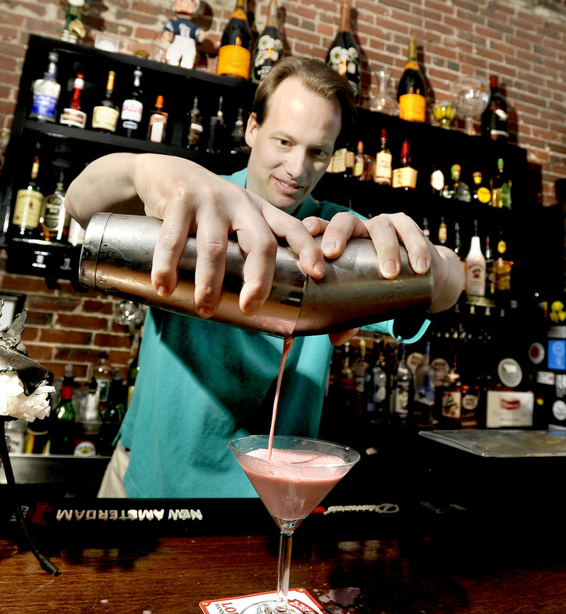 Slainte Wine Bar & Lounge owner and bartender Ian Farnsworth mixes and pours one of Slainte's signature martinis – the PB & J.