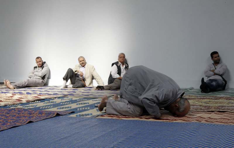 French Muslims attend prayer at a hall in an unused former fire station in Paris. There is a get-out-the-vote push among some Islamic groups in France.