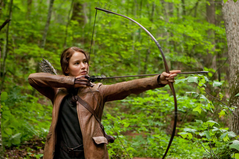 """Jennifer Lawrence stars as Katniss Everdeen in """"The Hunger Games,"""" the movie based on the dystopian trilogy of books. The series is engaging and well-written but too disturbing for children under 12, a reader says."""