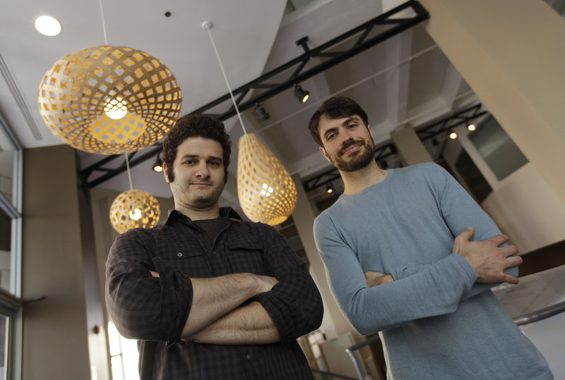 Dustin Moskovitz, left, and Justin Rosenstein, co-founders of the San Francisco-based software company Asana, are working on an online collaboration app that Moskovitz says will become the world's next $100 billion company.