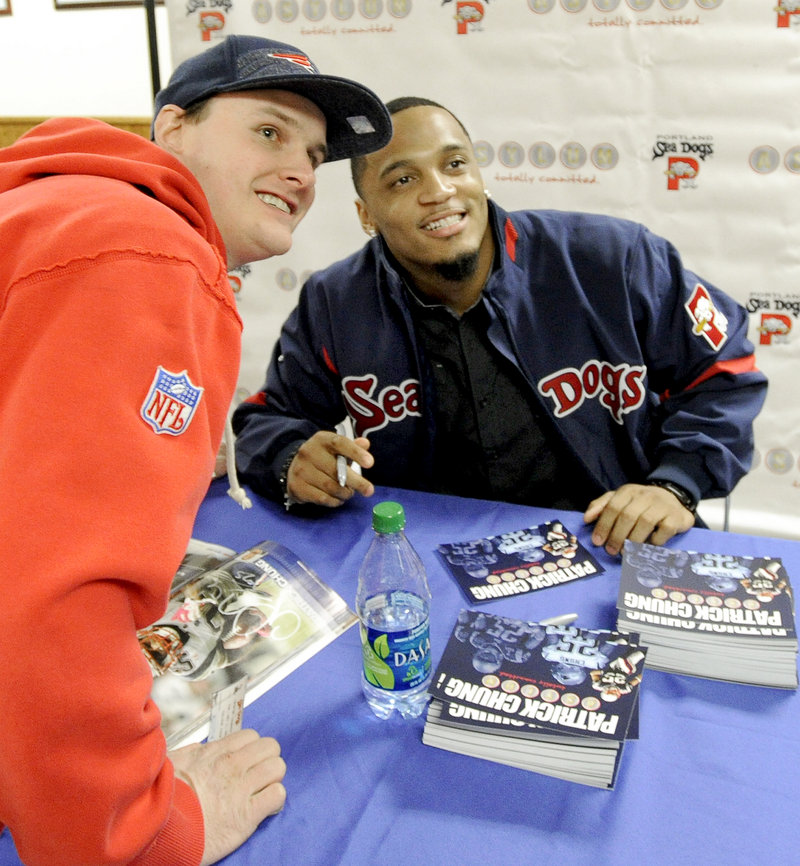 Jared Tarbox of Lyman poses with Patriots safety Patrick Chung Tuesday night at Hadlock Field. Chung signed autographs for almost an hour.
