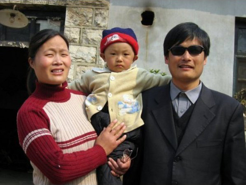 Blind Chinese legal activist Chen Guangchen, with his son, Chen Kerui, and his wife, Yuan Weijing, escaped house arrest into what activists say is U.S. diplomatic protection in Beijing.