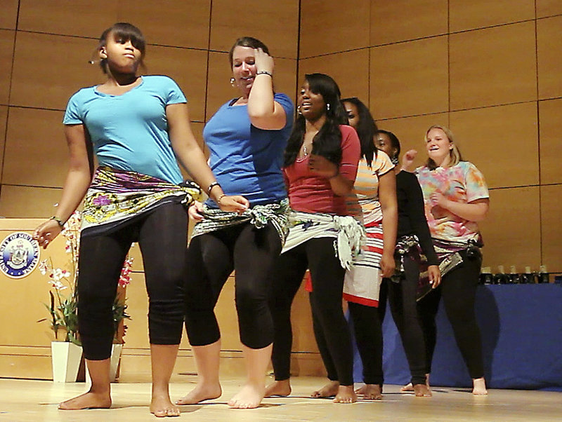 University of New England students, from left, Veneranda Kirway, Bailey Booras, Melissa Hue, Chinonye Okeke, Amanda Madu and Jessica Breslin perform a dance Tuesday night at the Multicultural and International Graduation Celebration at Hannaford Hall at the University of Southern Maine in Portland. Students from UNE, USM and Southern Maine Community College took part.