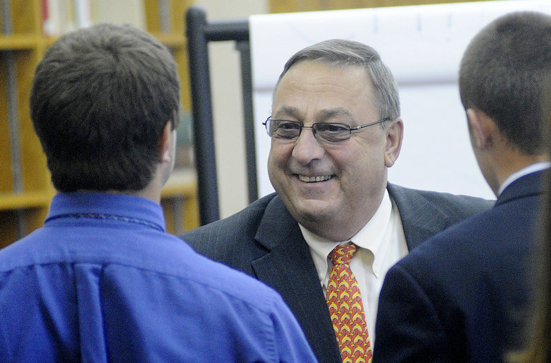 Gov. Paul LePage speaks with Cheverus High School students on Wednesday.