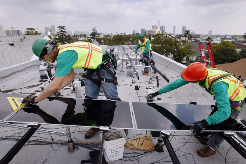 Workers for SolarCity, the nation's largest solar power installer, set up thin-film panels on the roof of a home in Los Angeles. Most of the jobs in the U.S. solar industry are in installing, sales and distribution.