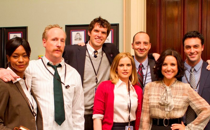 Tim Simons, center rear, with the cast of HBO's