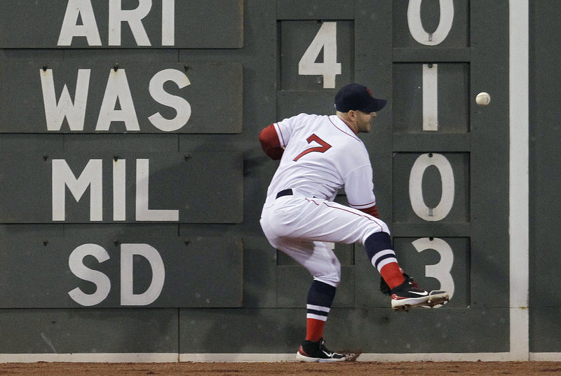 Cody Ross fails to catch a double off the wall by Oakland's Yoenis Cespedes in the fourth Wednesday at Fenway Park. Cespedes scored the game's first run later that inning.