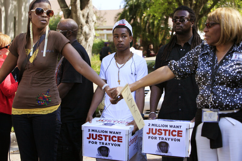 Demonstrators rally for Trayvon Martin in Sanford, Fla. A successful online petition launched after his death gathered 2.2 million signatures calling for the shooter's arrest.