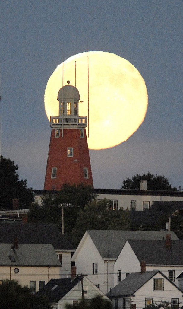 A view of a full moon from across Back Cove several years ago accents the Portland Observatory on Portland's Munjoy Hill. Despite many beliefs, the full moon doesn't cause unusual events, a psychologist says.