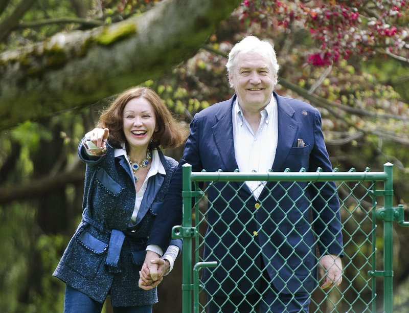 Conrad Black and his wife, Barbara Amiel Black, watch their two dogs in Toronto on Friday. Black was convicted of fraud and obstruction of justice charges in Chicago in 2007.