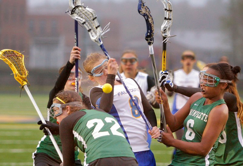 The ball gets knocked away from Angela Mallis of Falmouth under pressure from Waynflete's Jo Moore, 22, and Rhiannan Jackson, right. Waynflete improved to 6-0 and handed Falmouth its first loss of the season, 13-10.