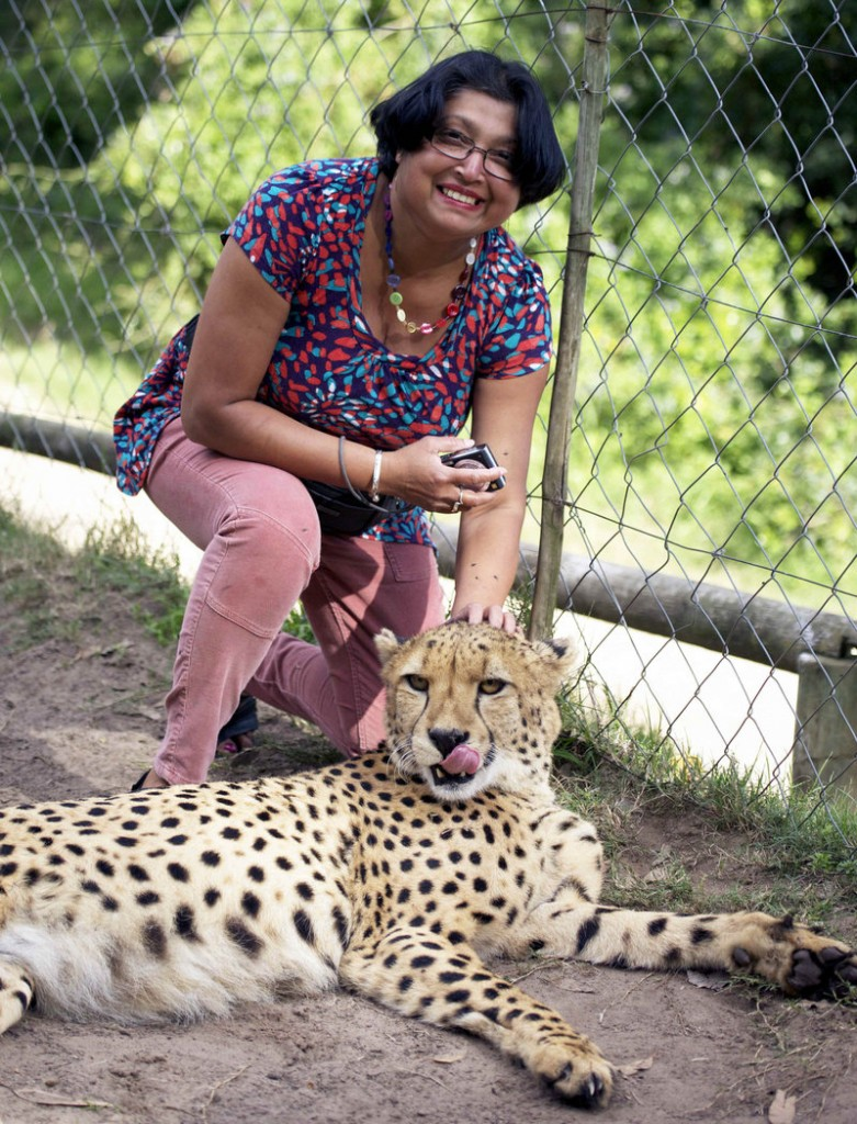 Violet D'Mello of Aberdeen, Scotland, smiles in a petting enclosure with a human-raised cheetah, left, shortly before she was attacked by the two cheetahs.