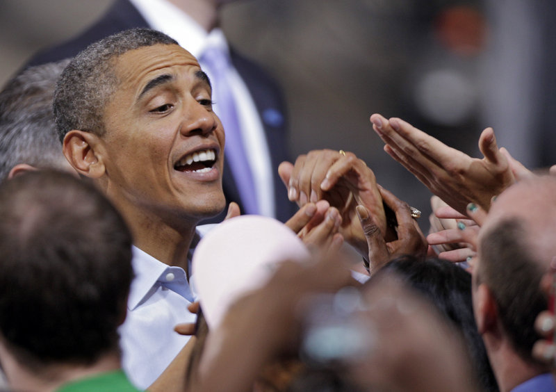 President Obama greets supporters after a campaign rally at Ohio State University in Columbus on Saturday. He portrayed Mitt Romney as a threat to the middle class and tried to soften the impact of what is likely to be the GOP's best campaign issue: the economy.