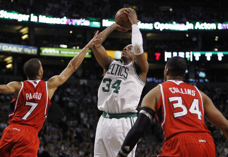 Paul Pierce goes up for a shot against Jannero Pargo of the Hawks as Jason Collins looks on. Pierce scored 24 points in just 18 minutes, getting some extra rest as Boston looks ahead to Game 5 in Atlanta on Tuesday night.