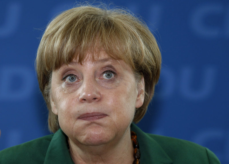 German Chancellor Angela Merkel reacts at a meeting of the German Christian Democratic party in Berlin on Monday. Voters in Germany's northernmost state on Sunday ousted a governing center-right government made up of the same parties as Merkel's federal coalition. For Merkel, the defeat could be an omen of worse to come.