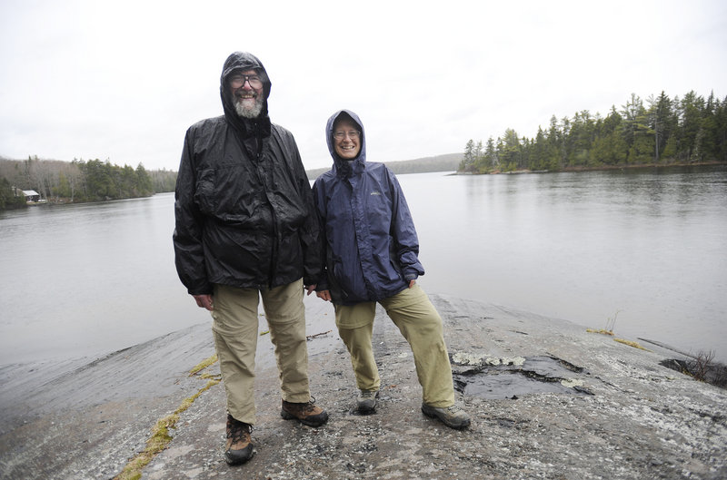 Stan and Michelle Moody, on the shore of Spectacle Pond off the Appalachian Trail in Monson, maintain a section of the trail and have a camp in nearby Elliotsville. They will help with the June 21 ceremony that will designate Monson as an official Appalachian Trail town.