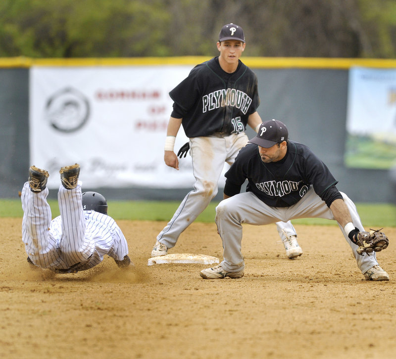 Ryan McIntosh of Plymouth State prepares to put the tag on Southern Maine's John Carey, who was caught trying to steal second base in the ninth inning Wednesday. Plymouth State won 3-2 in the first game of the Little East baseball tournament.