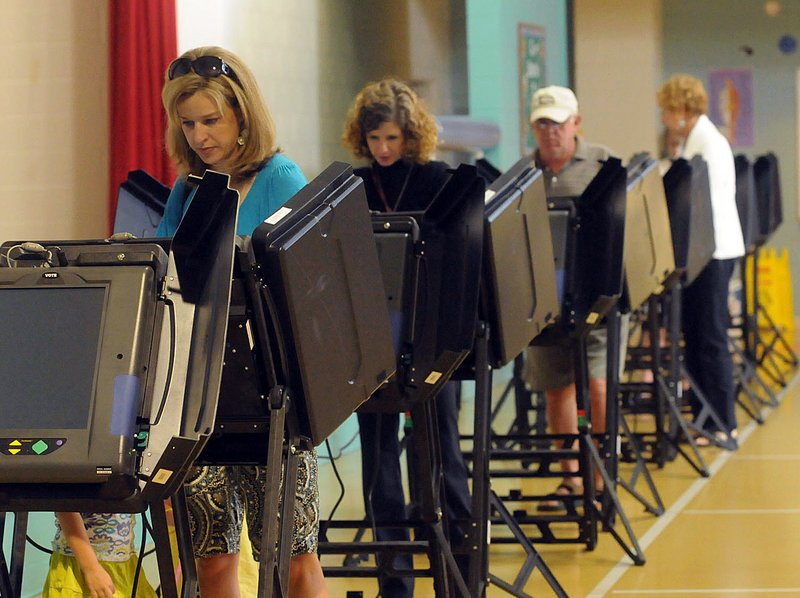 Gretchen Colby casts her vote Tuesday in Brunswick County, N.C. North Carolina voters came out strongly in favor of a ban on same-sex marriage, but national polls suggest supporters of gay marriage rights slightly outnumber opponents.