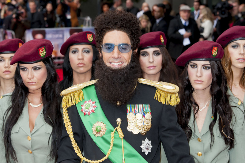 In character, British actor Sacha Baron Cohen arrives for the world premiere of