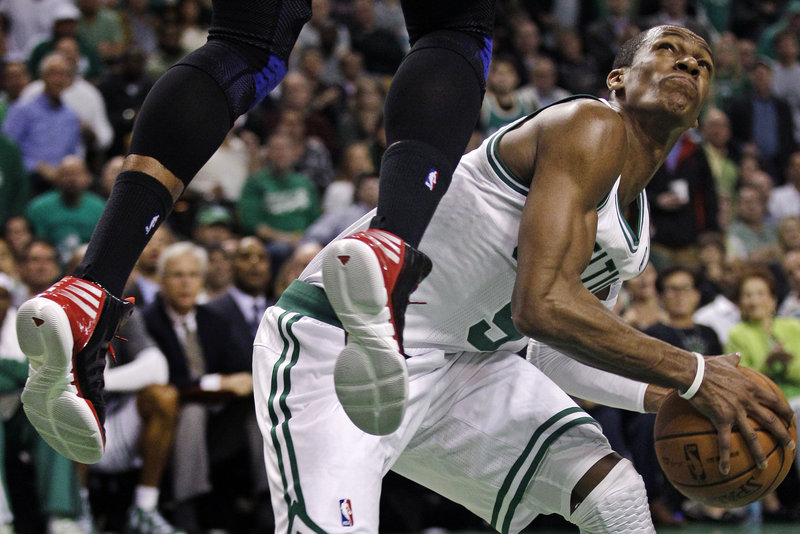 Rajon Rondo of the Boston Celtics ignores the feet to perform a feat. Puns aside, Rondo faked Josh Smith of the Atlanta Hawks more than a little out of position and headed to the basket during the second quarter of Boston's series-clinching victory in Game 6.