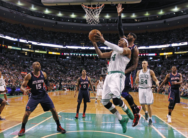 Paul Pierce of the Boston Celtics has inside position to drive against Josh Smith of the Atlanta Hawks, who has no weak-side help from Al Horford in the first quarter.