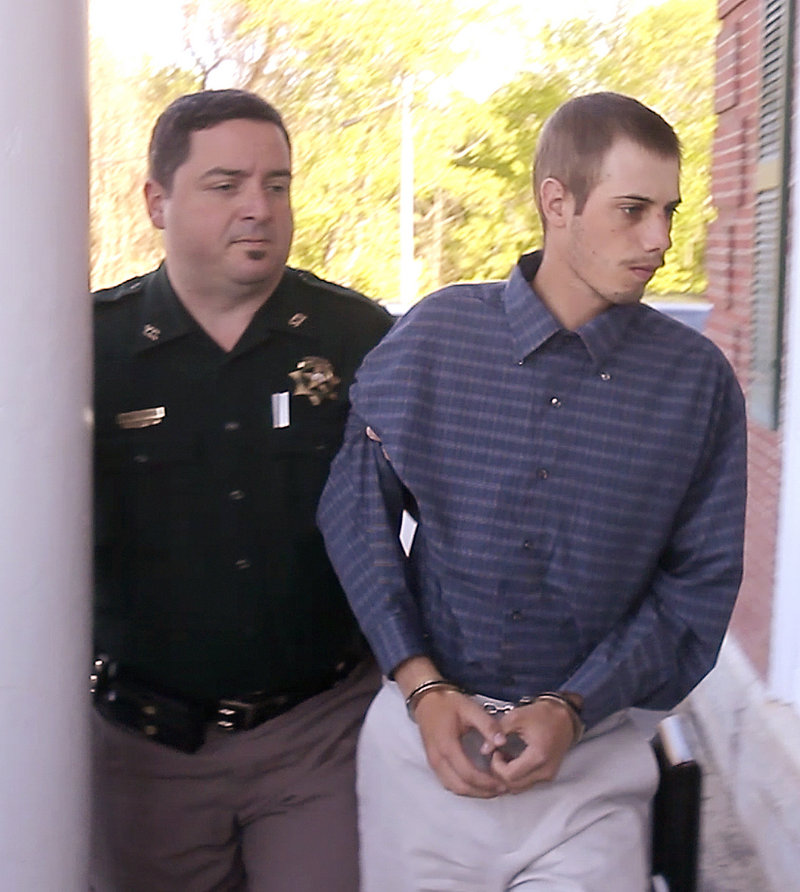 Gordon Collins-Faunce is led into York County Superior Court in Alfred on Friday. Collins-Faunce was charged with depraved indifference murder in the death of his infant son and is being held at the York County Jail in lieu of $100,000 bail.