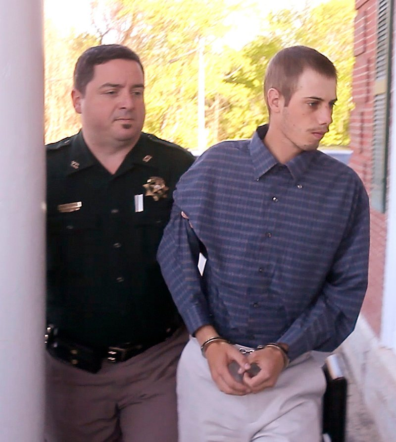 Gordon Collins-Faunce is led into York County Superior Court in Alfred on May 11. Collins-Faunce was charged with depraved indifference murder and is being held on $100,000 bail.